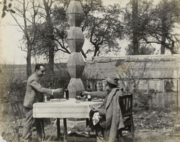 Brancusi and Man Ray having a toast in front of Endless Column I, fall 1927 (1)